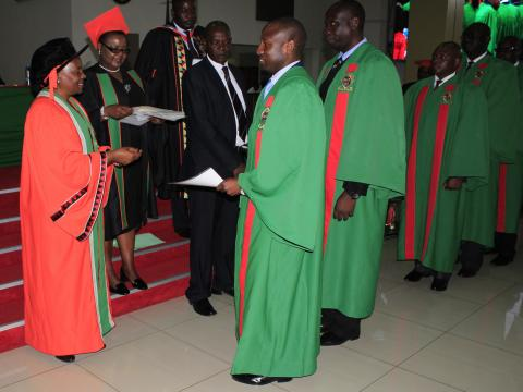 Acting Vice-Chancellor, Prof. Enala Tembo-Mwase giving out Diploma Certifcates to 55 ZNS graduands