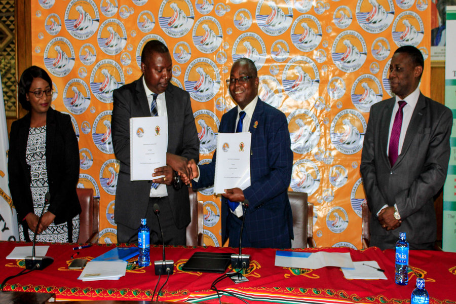 UNZA Vice Chancellor exchanging documents with Lusaka Water and Sewerage Company Managing Director