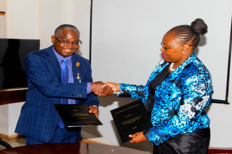 UNZA Vice-Chancellor Professor Luke Mumba shakes hands with MCDSS PS, Mrs Pamela Kabamba after signing the MoU