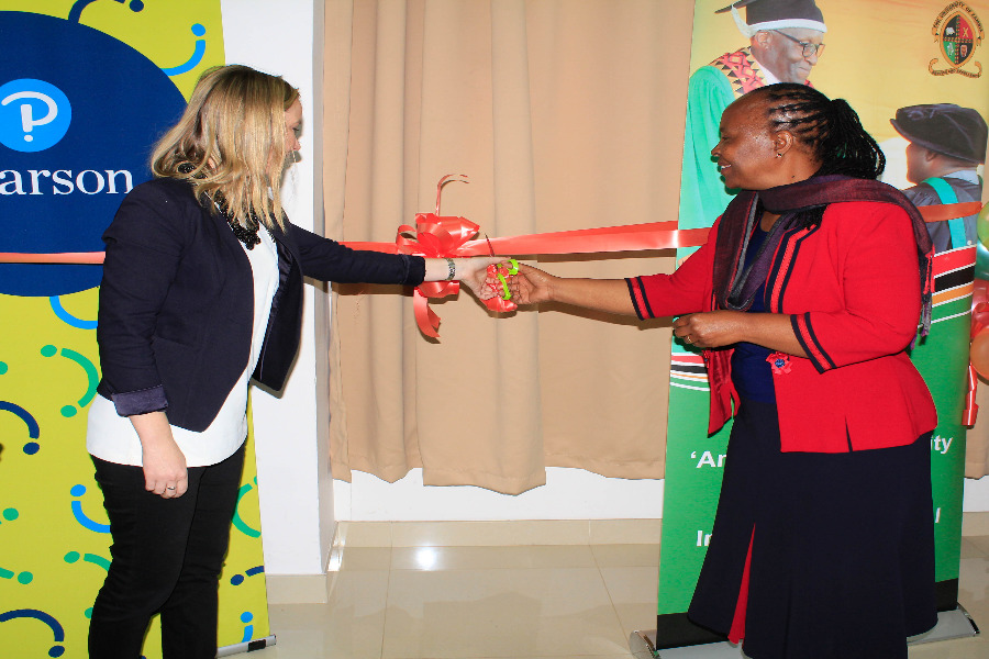 Acting Vice-Chancellor Prof Enala Mwase and Pearson International Head of Business Development, Ms Christine Hayes cutting the ribon during the launch