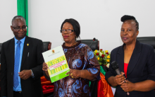 Minister of Higher Education (c) accompanied by the Vice Chancellor (l) and the Deputy Vice Chancellor (R) displays the launched Quality Assurance Framework document